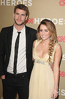 Liam Hemsworth and Miley Cyrus at the CNN Heroes: An All-Star Tribute at The Shrine Auditorium on December 11, 2011 in Los Angeles, California.