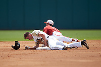 North Carolina State Wolfpack shortstop Will Wilson (8) falls over Jacob Hurtubise (39) of the Army Black Knights after tagging him out on an attempted steal of second base at Doak Field at Dail Park on June 3, 2018 in Raleigh, North Carolina. The Wolfpack defeated the Black Knights 11-1. (Brian Westerholt/Four Seam Images)