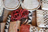 Woven pandanus leaf souvenirs and beads at Utukalongalu Market in Tonga