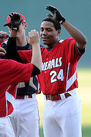 K.J. Bryant (24) of the Wade Hampton High School Generals high-fives a teammate before a game against the Byrnes High School Rebels on Wednesday, April 23, 2014, at Fluor Field at the West End in Greenville, South Carolina. Bryant is the nation's No. 71 top high school prospect, according to Baseball America. (Tom Priddy/Four Seam Images)