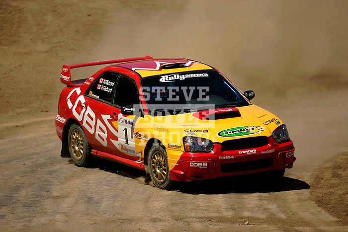 Driver Patrick Richard and co-driver Nathalie Richard come around a turn near the finish line while competing in the Rally Car Race finals during X-Games 12 in Los Angeles, California on August 5, 2006.