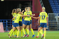 YOKOHAMA, JAPAN - AUGUST 6: Team Sweden celebrates the goal by Stina Blackstenius #11 of Sweden during a game between Canada and Sweden at International Stadium Yokohama on August 6, 2021 in Yokohama, Japan.