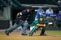 Miami Hurricanes catcher Joe Gomez (40) sets a target as home plate umpire Danny Everett looks on during the game against the North Carolina Tar Heels in the second semifinal of the 2017 ACC Baseball Championship at Louisville Slugger Field on May 27, 2017 in Louisville, Kentucky. The Tar Heels defeated the Hurricanes 12-4. (Brian Westerholt/Four Seam Images)