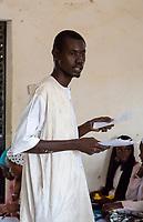Senegal, Touba.  Teacher in his Classroom at the Al-Azhar Islamic Institute.