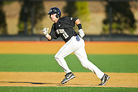 Pat Blair (11) of the Wake Forest Demon Deacons takes off for second base against the West Virginia Mountaineers at Wake Forest Baseball Park on February 24, 2013 in Winston-Salem, North Carolina.  The Demon Deacons defeated the Mountaineers 11-3.  (Brian Westerholt/Four Seam Images)