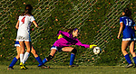 LITCHFIELD, CT-110620S08 —Litchfield goalkeeper Mackenzie Schweter managed to get a hand on the ball to stop a goal on a header by Northwestern's Elle Crone (4) during their Berkshire League game Friday at Litchfield High School. <br /> Jim Shannon Republican-American
