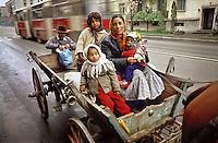 ROMANIA, Bucharest, 1975..Gypsu family on their horse cart in the Floreasca street..ROUMANIE, Bucarest, 1975..Falmille tsigane dans leur charette tirée par un cheval sur la rue Floreasca..© Andrei Pandele / EST&OST