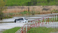 A car sits abandoned Thursday, April 29, 2021, in deep water along Dead Horse Mountain Road in Fayetteville. Heavy rains over Wednesday and Thursday have swollen the White River outside of its banks, causing the road to flood. Visit nwaonline.com/210430Daily/ for today's photo gallery. <br /> (NWA Democrat-Gazette/Andy Shupe)
