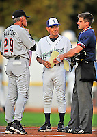 3 September 2008: Tri-City Valley Cats Manager Pete Rancont (left) exchanges roster cards with Vermont Lake Monsters Manager Ramon Aviles (center) along with home plate umpire Joseph Born (right) prior to a NY Penn-League game at Centennial Field in Burlington, Vermont. The Lake Monsters defeated the Valley Cats 6-5 in extra innings. Mandatory Photo Credit: Ed Wolfstein Photo