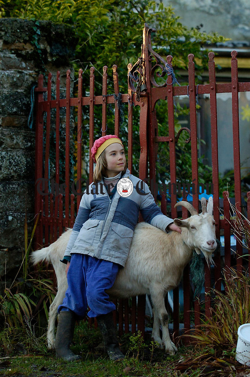 Young Jonas Czech  minding Mickalla at Tuamgraney. Photograph by John Kelly.