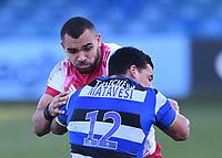6th February 2021; Recreation Ground, Bath, Somerset, England; English Premiership Rugby, Bath versus Harlequins; Josh Matavesi of Bath tackles Joe Marchant of Harlequins