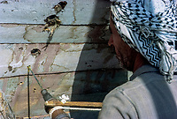 Kuwait April 1967.  Carpenter Using Hand-powered Drill to Drill Holes in Dhow under Construction.