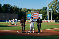 Mahoning Valley Scrappers catcher Yainer Diaz (48) stands in between umpires Jesse Busch (left) and Tre Jester (right) during the national anthem before a NY-Penn League game against the State College Spikes on August 29, 2019 at Eastwood Field in Niles, Ohio.  State College defeated Mahoning Valley 8-1.  (Mike Janes/Four Seam Images)