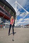 """The Welsh singer Katherine Jenkins poses with a golf club outside the Millennium Stadium in Cardiff today. She has been announced as the first major artist confirmed to perform at the """"Welcome to Wales"""" concert at the Millennium Stadium to mark the start of the 2010 Ryder Cup in Wales later this year.."""