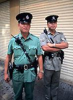 Policemen protecting public in Hong Kong Island toda