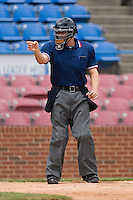 Home plate umpire Chris Segal signals a strike during the Carolina League contest between the Lynchburg Hillcats and the Winston-Salem Warthogs at Ernie Shore Field in Winston-Salem, NC, Wednesday May 14, 2008.
