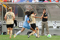 FC Gold Pride head coach Albertin Montoya watches as Marta (10) plays the ball. FC Gold Pride defeated Sky Blue FC 1-0 during a Women's Professional Soccer (WPS) match at Yurcak Field in Piscataway, NJ, on May 1, 2010.