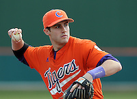 Infielder John Hinson (4) of the Clemson Tigers in a game against the Eastern Michigan Eagles on Friday, Feb. 18, 2011, at Doug Kingsmore Stadium in Clemson, S.C. Photo by Tom Priddy / Four Seam Images
