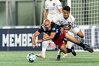 FOXBOROUGH, MA - AUGUST 7: Tiago Mendonca #33 of New England Revolution II and Raul Aguilera #45 of Orlando City B battle for the ball in the penalty area during a game between Orlando City B and New England Revolution II at Gillette Stadium on August 7, 2020 in Foxborough, Massachusetts.