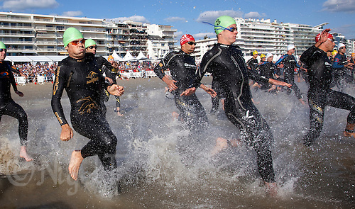 18 SEP 2010 - LA BAULE, FRA - EC Sartrouville team mates, Javier Gomez (left) and Jonathan Brownlee (second from right), race into the water at the start of the 2010 Mens French Club Championship Final .(PHOTO (C) NIGEL FARROW)