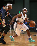 Reno Bighorns' Tajuan Porter and Bakersfield Jam's Billy Baptist compete in a D-League basketball game in Reno, Nev., on Tuesday, Jan. 14, 2014. The Bighorns won 93-85.<br /> Photo by Cathleen Allison