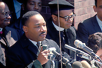 Selma to Montgomery March for voting rights. Martin Luther King leading prayer on steps of Brown's Chapel, Selma, at beginning of march. Civil Rights. Black. African American.