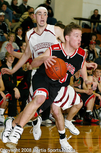 LEAD, SD - JANUARY 22 --  Tanner Urbaniak #34 of Sturgis drives past Tanner Adler #21 of Lead-Deadwood during their game Thursday evening at the Lead-Deadwood High Gym. (Photo by Dick Carlson/Inertia).
