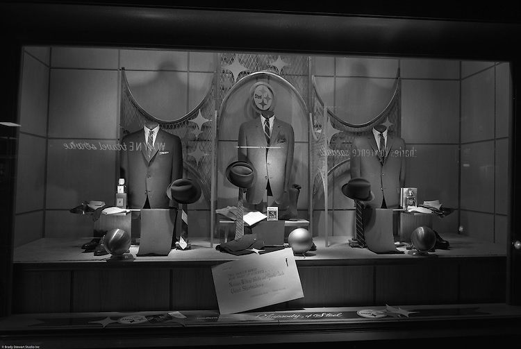 Client: US Steel<br /> Ad Agency: US Steel Marketing<br /> Contact:<br /> Product: Steel displays and fixtures and consumer products made from steel.<br /> Location: Hornes Department Store in downtown Pittsburgh<br /> <br /> View of Christmas window display at Horne's department store in downtown Pittsburgh. Men's suits and accessories on display during the Rhapsody of Steel campaign. US Steel launched an awareness campaign of all the current uses of steel in everyday products.  During this time, ALCOA Aluminum Company of America also headquartered in Pittsburgh, was aggressively competing to enter markets where US  steel companies traditionally dominated market share. Examples included beer and food Cans, appliances, automobile parts, children's toys/bicycles, and more.