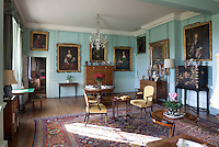 Duck-egg blue and white library. A portrait of Augustus FitzRoy, 3rd Duke of Grafton hangs above the door on the left