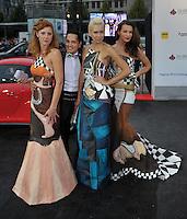 Opernball 2013 am 14.09.2013 in Leipzig (Sachsen). <br /> IM BILD: Designer Augustin Molina mit Models, die seine Kleider tragen. <br /> Foto: Christian Nitsche