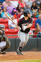 Brent Tanner (23) of the Kannapolis Intimidators follows through on his swing against the Hickory Crawdads at L.P. Frans Stadium on May 25, 2013 in Hickory, North Carolina.  The Crawdads defeated the Intimidators 14-3.  (Brian Westerholt/Four Seam Images)