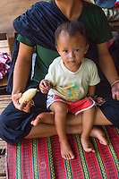 Thailand, Mae Hong Son. Woman and baby from Lahu tribe in northern Thailand.