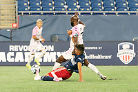 FOXBOROUGH, MA - SEPTEMBER 04: Nicolas Firmino #29 of New England Revolution II tackles Don Smart #7 Forward Madison FC during a game between Forward Madison FC and New England Revolution II at Gillette Stadium on September 04, 2020 in Foxborough, Massachusetts.
