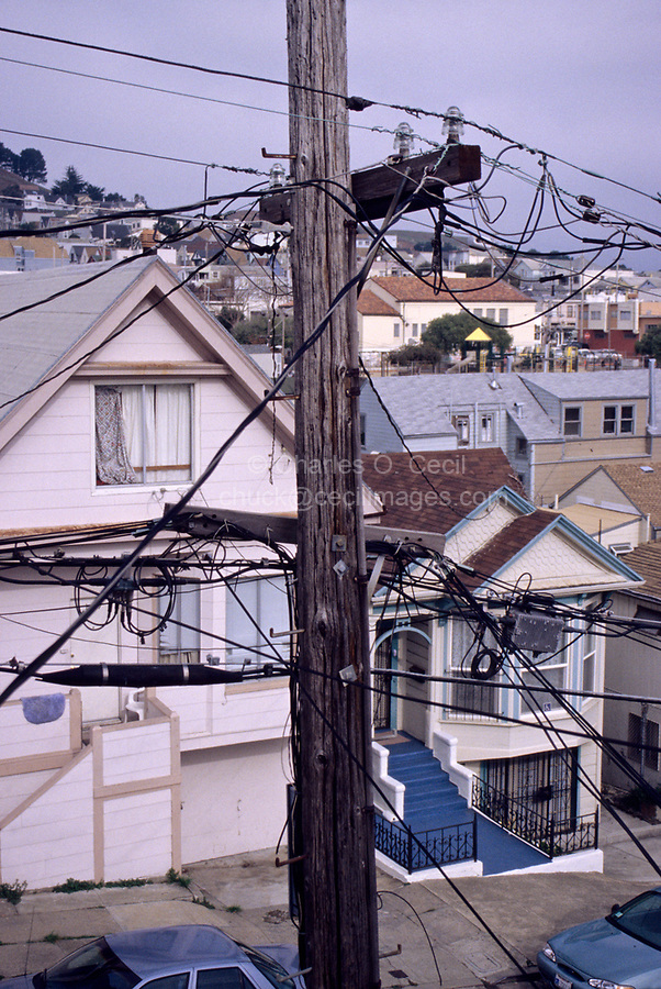 San Francisco, California - Visual Pollution, Bernal Hills District.  Telephone and Electric Wires Interfere with the View from the Living Room of this House in Bernal Hills.