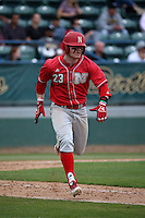 Jake Placzek (23) of the Nebraska Cornhuskers runs to first base during a game against the Long Beach State Dirtbags in the first game of a doubleheader at Blair Field on March 5, 2016 in Long Beach, California. Long Beach State defeated Nebraska, 1-0. (Larry Goren/Four Seam Images)