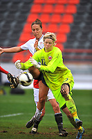 USA's Lauren Cheney attempts to twist a shot around the Norwegian keeper.  The USA defeated Norway 2-1 at Olhao Stadium on February 26, 2010 at the Algarve Cup.