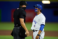 Dunedin Blue Jays manager Luis Hurtado (13) argues a call with umpire Casey James during a game against the Bradenton Marauders on June 5, 2021 at TD Ballpark in Dunedin, Florida.  (Mike Janes/Four Seam Images)