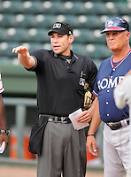 Umpire Tyler Curtis talks with manager Randy Ingle of the Rome Braves prior to a game against the Greenville Drive on August 13, 2012, at Fluor Field at the West End in Greenville, South Carolina. Rome won, 3-2. (Tom Priddy/Four Seam Images)