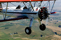 aerial photograph of a Stearman in-flight over Sonoma County, California