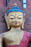 Kathmandu, Nepal.  This Buddha Statue on the grounds of the Swayambhunath temple complex is called the Dhyani Buddha Aksobhya.  The third eye in the middle of the forehead symbolizes the all-seeing, all-knowing quality of the Buddha.
