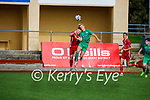 Kerry's Odhran Ferris and Charlie O'Brien of Cork take to the air and tussle for possession in the U17 EA Sports soccer League