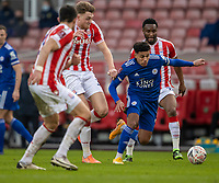 9th January 2021; Bet365 Stadium, Stoke, Staffordshire, England; English FA Cup Football, Carabao Cup, Stoke City versus Leicester City; James Justin of Leicester City makes a break between Stoke defenders