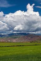 Peru, Moray, Urubamba Valley.   Farmland, Andes Foothills in Background.