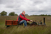 BNPS.co.uk (01202 558833)<br /> Pic: Zachary Culpin/BNPS<br /> <br /> Dave Smith fires up his miniature Burrell Agricultural steam engine before making his way to the show ground at the Organford Classic Vehicle Show in Dorset on Sunday afternoon. Dave's Steam engine can reach speeds of up to 5mph.<br /> <br /> Despite the gloomy weather visitors were treated to classic cars, stationary engines, motorbikes and even tanks.