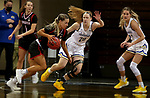 SIOUX FALLS, SD - MARCH 6: Sophie Johnston #42 of the Omaha Mavericks drives against Tori Nelson #20 of the South Dakota State Jackrabbits during the Summit League Basketball Tournament at the Sanford Pentagon in Sioux Falls, SD. (Photo by Dave Eggen/Inertia)