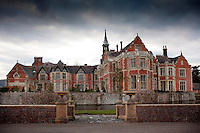 The 16th century building was remodelled and enlarged in the 19th century, giving it the appearance of an Elizabethan stately home in the Arts and Crafts style