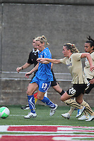 Kristine Lilly (left) and Camile Abily (right) go down the sideline in Bay Area's 2-1 win at Boston