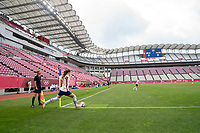 KASHIMA, JAPAN - AUGUST 2: Tierna Davidson #12 of the USWNT takes a corner kick during a game between Canada and USWNT at Kashima Soccer Stadium on August 2, 2021 in Kashima, Japan.