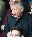 FORMER HEARTS' MANAGER JIM JEFFERIES TAKES HIS SEAT IN THE STAND AT TYNECASTLE