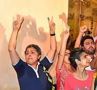 13 October 2019, Tunisia, Tunis: Supporters of Tunisian presidential candidate Kais Saied celebrate after a polling agency says that Saied has overwhelmingly won Tunisia's presidential run-off.